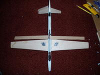 Name: P9140005.jpg Views: 114 Size: 108.0 KB Description: Bottom view: V-tail hot glued on. Elevator servo installed in rear. Lost model beeper installed behind wing (acts as elevator servo extension). Had to take case off of Rx to fit. Battery (2/3AAA) installed in upper front of nose.