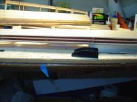 Name: DSC00716.jpg Views: 255 Size: 32.8 KB Description: Paper and tape 'clamps' removed and the sheet is waiting to be glued down to the ribs. The sheet is cut oversize.
