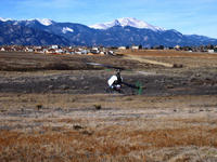 Name: steve's raptor 001.jpg Views: 576 Size: 137.8 KB Description: Raptor 50-v2 (pikes peak in background)