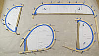 Name: tail_laminations_glued_up.jpg Views: 211 Size: 80.6 KB Description: I just learned about using brass strip to hold these curves while gluing, but it was too late for this go round.