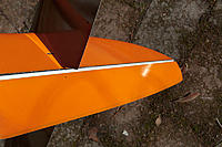 Name: aspire-8569.jpg Views: 369 Size: 110.9 KB Description: If you want really large rudder deflection, take a look at the rudder wiper. Sometimes it hots the opposite side, limiting left rudder movement to about 22-23mm. I sanded the wiper little shorter at around 2/3 height. Only very light sanding needed.
