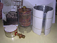 Name: image0004.jpg Views: 343 Size: 60.3 KB Description: Burner, boiler, windscreen. Since the ceramic burner needs little flame space, the boiler can be mounted lower than any other firing system I have used before. The burner fits inside the galvanized screen boiler wrapper.