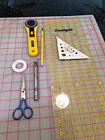 Name: BC Sail Making Tools.jpg Views: 9 Size: 4.40 MB Description: These are the tools (in addition to a sewing machine) that I find helpful; roll of Wonder Tape, sharp scissors, rotary cutting tool, model knife, pencil, Omnigrid cutting guide, and a square.  My wife is a quilter, and she taught me how to sew.