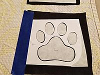 Name: BC Logo 2.jpg Views: 8 Size: 3.14 MB Description: A master blank template is made out of paper.  The paw has been cut out.  A pencil is used to draw out the pads on the paper side of the Heat n Bond.  The template is taped to the logo so that it won't move.