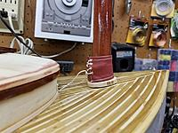 """Name: BC Upholstery Mast Boot .jpg Views: 22 Size: 2.93 MB Description: This is the mast boot.  The bottom wood donut will eventually be glued to the deck.  There is a rolled section of 1/32""""  plywood that extends up an inch (creating a tube around the mast).  The boot has a lace that holds it to the mast."""