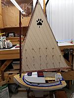 Name: BC Sail Build.jpg Views: 17 Size: 3.41 MB Description: The sail was mocked-up today as I figure out where to install the hardware.  I like to have the sail sewn and fit the mast, boom, and gaff to the sail.  It is still easier for me to work with wood than cloth.