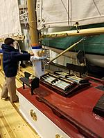 Name: Boom vang.jpg Views: 8 Size: 3.51 MB Description: This is how I build boom Vangs; swivel on the mast, cut a turnbuckle in half, solder each end to a tube, and attach a tang to the boom.  To gum up the threads to make sure it doesn't unwind, I'll put some caulking on the threads - still adjustable.