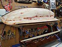 Name: PC Keel Slot.jpg Views: 58 Size: 149.1 KB Description: Here she is with her keel slot open.  That entire void is filled with an 17-18 lb. bar of lead.  The keel is screwed, bolted, and glued in place.  The keel cap is installed.  The keel cap is coated in a layer of 6 oz. fiberglass.