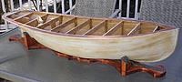 Name: Weymouth Project Glassed and Sanded.jpg Views: 210 Size: 163.8 KB Description: Boat C sitting on her boat stand.