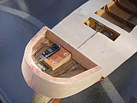 Name: 002.jpg Views: 241 Size: 220.4 KB Description: The rudder servo has been screwed to a wooden plate, which in turn has been screwed into the keel.  Covered the transom as well.