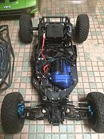 Name: Yeti-3.jpg Views: 3 Size: 64.2 KB Description: This view shows the metal/ blue transmission and gear cover.  It has RPM A-arms, the blue aluminum knuckles and C hubs and adjustable links.
