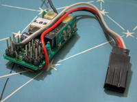 Name: RX-PinSide1.jpg Views: 213 Size: 67.0 KB Description: This plug drives the throttle signal from channel 3 to the ESC input. The black wire is connected the ground, while the white cable gets the signal. Red wire brings power to the RX from the BEC.
