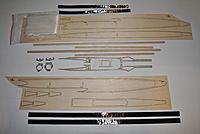 Name: DSC_0862.jpg Views: 185 Size: 443.8 KB Description: Wood pod Kit  Triangular balsa stock Laser cut parts Plywood reinforcement FIberglass  In Hardware bag Unidirectional carbon Aluminum inserts Servo tray