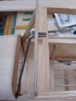 Name: DSC01842.jpg Views: 457 Size: 54.2 KB Description: Cabin braces serve as wing leading edge hold-down.