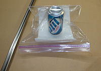 Name: DSC03849.jpg Views: 125 Size: 145.7 KB Description: Aluminum adult beverage can in a 1-gallon Ziploc bag. Paper towel is so the air inside the can can be evacuated.