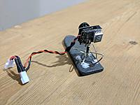 Name: IMG_20170909_162757.jpg Views: 18 Size: 606.8 KB Description: video transmitting antenna is glued directly to the foam board.  Camera tilt is adjusted by bending the antenna connector