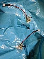 Name: IMG_20180725_200637_01.jpg Views: 26 Size: 251.7 KB Description: Both motor controllers attached to the envelope, battery connectors attached.  A comparatively large capacitor is needed to keep the ATTiny from flipping out when motor power applied.  The motor wires are inside the envelope, soldered through