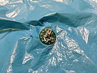 Name: IMG_20180725_194608.jpg Views: 20 Size: 295.6 KB Description: Motor pod mound heat melted to the foil.  There's a matching mount pad behind it.  You can see the wires have been pushed through the foil and soldered to the circuit pads.  That alone should be enough to seal them.