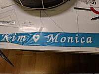Name: IMG_20180803_025918.jpg Views: 12 Size: 2.99 MB Description: The foil strip before it was wrapped around the balsa frame.  Lettering was cut from white vinyl stick on paper.