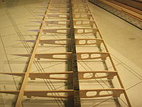 Name: IMG_3067.jpg Views: 740 Size: 193.0 KB Description: simple ladder framing with kevlar wrapped spar (I used thread, tow is ideal) !/4'' balsa trail spar (for flaps & ailerons) 1/16'' balsa false leading edge