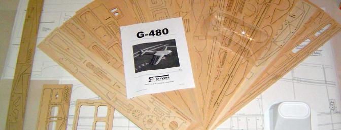 The complete kit contents, including laser cut balsa, laser cut plywood, complete hardware kit, vacuum formed plastic canopy, vacuum formed plastic cowling, and instruction manual.