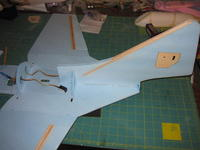 Name: F-9F buildpic 032.jpg Views: 252 Size: 65.0 KB Description: cut a hole in the planform and feed the elevator control sheath through, then seat the fin and glue in place.  the formers naturally align the fin correctly