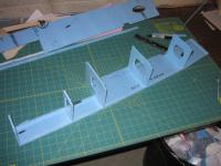 Name: F-111 118% build 12.jpg Views: 493 Size: 85.5 KB Description: and finally bulkhead #5.  you can see the other fuse side being prepped at the top of the pic.