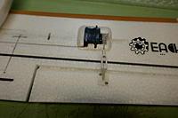 Name: P1000117.jpg Views: 5 Size: 277.1 KB Description: Aileron servo pushrod swapped to square alignment.