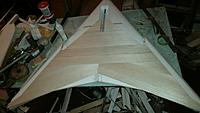 Name: 20180920_064144.jpg Views: 38 Size: 552.8 KB Description: Much of the sheeting complete.  Wing is straight and true, and stable enough that my worries of a warp are now past.
