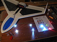 Name: IMG_1096.jpg Views: 43 Size: 177.9 KB Description: Wing lights completed, red for port wingtips, green for starboard.  The white LED's will be covered with red and green packing tape for the rest of the wing.