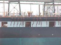 Name: Midships & Capstan.jpg Views: 332 Size: 28.8 KB Description: Note the silver painted iron hammock stanchions on the cap rail.