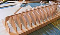 Name: con10sep15f.jpg Views: 101 Size: 57.6 KB Description: Keel assembled and transom attached - sitting on forms.