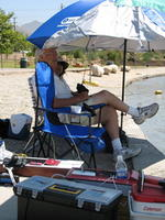 Name: IMG_0386.jpg Views: 95 Size: 123.2 KB Description: Sausage Man Rich, homesteading under our shade.... LOL