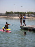Name: IMG_0380.jpg Views: 116 Size: 89.0 KB Description: Senior lifeguards, instructing junior life guards, to the rules of water polo on surfboards and swimming.