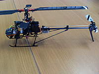Name: SL371427.jpg Views: 276 Size: 75.7 KB Description: Older landing gear and JJ's long fin work very well together. Both lighter than stock and more clearance for the tail rotor. Suits 120 longer blades as well.