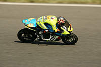 Name: NO5A8974a.jpg Views: 381 Size: 36.1 KB Description: The bike I raced.. KP09n proto chassis, OS.18 engine..