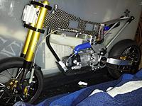 Name: IMG_20121013_220652.jpg Views: 65 Size: 268.0 KB Description: Lightened top frame w/crash back mech..