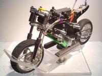 Name: 1-5eWorldsBike-05.jpg Views: 736 Size: 79.4 KB Description: Customised TTn/e chassis... Batteries - 7.4v/2100mAh/20-30C/Lipos.. Motor - Novak GTB/6.5 Brushless system.. Spektrum radio gear.. Hi-Tech servos...