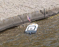 Name: res010.jpg Views: 102 Size: 132.6 KB Description: Brads boat drifted onto the rocks at low tide.