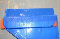 Name: 72_hinge_tape1.jpg Views: 507 Size: 39.2 KB Description: 72 - Put tape on vstab, position shim and rudder
