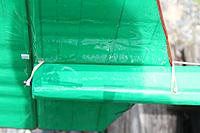 Name: 124_tail_mount_04.jpg Views: 342 Size: 65.6 KB Description: Rubber bands straddle fuselage sides and wrap around peg