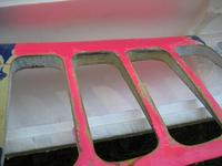 Name: IMG_5506.jpg Views: 99 Size: 36.5 KB Description: The pink area is glassed and the 2 center bays are full of glue.