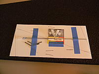 Name: DSCN2054.jpg Views: 72 Size: 167.2 KB Description: There is a piece of coroplast that has the winglets drawn, two spar jointers, two push rods and clevises, and a set of horns.