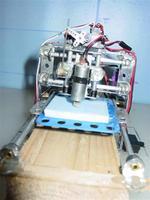 Name: DSC07795 (Medium).jpg Views: 2555 Size: 44.4 KB Description: Mini Mill remote controled (servo driven):)