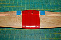 Name: Mini-Macchi_325.jpg Views: 69 Size: 303.4 KB Description: Tape the ailerons so they don't move. Pack clay into base of torque rods. Lay packing tape along center area of wing. Make sure you can still see the lines you drew on the wing!