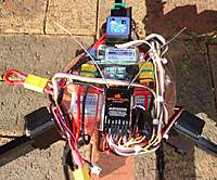 Name: TriWiringFinished.jpg Views: 251 Size: 134.2 KB Description: Yaw gyro, RX, Lipo Alarm and UBEC are all mounted on a clear plastic disc mounted over the speed controllers.