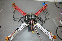 Name: DSCN6121.jpg Views: 349 Size: 280.8 KB Description: Trial fit... The esc is going on this position, the FC will go on top, on an additional tray held on top by those nylon bolts.