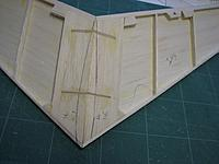 Name: IMG_0658.jpg Views: 50 Size: 188.3 KB Description: Two 1/16in ply dihedral braces join the halves. I sheeted the undersides to within 1/16in of the traced outline of the top of the fin, in the hope that the tailplane will self locate on the sheeted fin later.