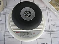 Name: IMG_1129.jpg Views: 307 Size: 157.5 KB Description: Original (Radio Active?) wheel. Plastic hub, hollow rubber tyre.