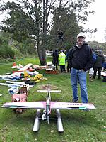 Name: 20190915_110951.jpg Views: 34 Size: 1.22 MB Description: My wife took this photo of me as a wayward plane is retrieved from the tree.